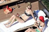 Brooklyn Decker chatted with a friend in her bikini in Australia.