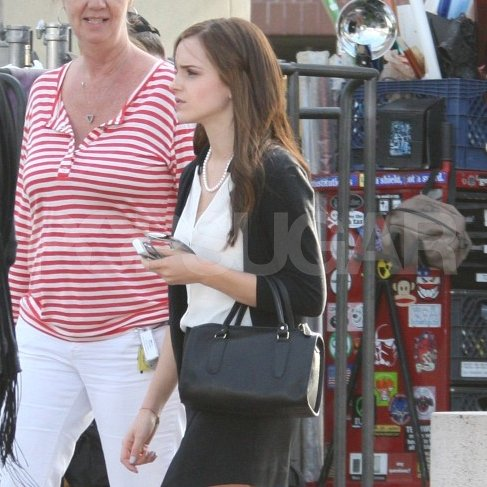 Emma Watson wore a black cardigan and pearls on the set of The Bling Ring in Lynwood, CA.