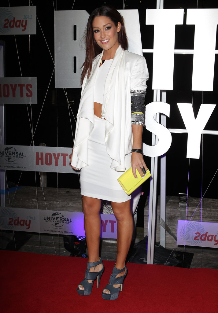 Erin McNaught wore a white dress with a cutout to the Battleship premiere in Sydney.