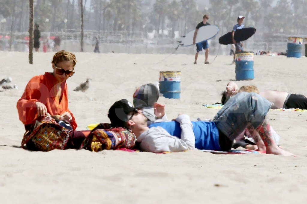 Nicole Richie and Joel Madden relaxed in the sand with Harlow and Sparrow on the beach in Malibu.