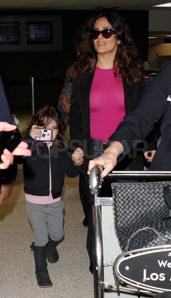 Salma Hayek and Valentina walked through the airport.