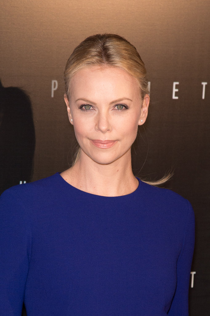 Charlize Theron wore her hair parted down the middle and pulled back to the Prometheus premiere in Paris.