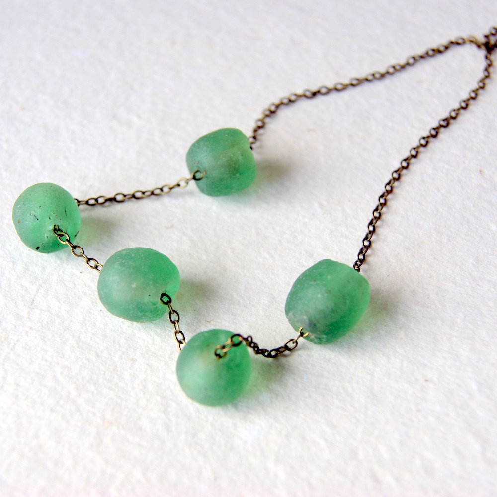 We adore the gorgeous mint green baubles, which seem to take on a floating effect when worn. Fun fact: these beads are actually recycled glass pieces from Africa. Recycled Glass Necklace in Mint Green ($22)