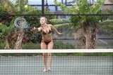 Hayden Panettiere hit the tennis ball across the net with boyfriend, New York Jets wide receiver, Scotty McKnight, in Hawaii.