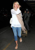 Cameron Diaz arrived in LA wearing a loose fitting white top and a scarf.