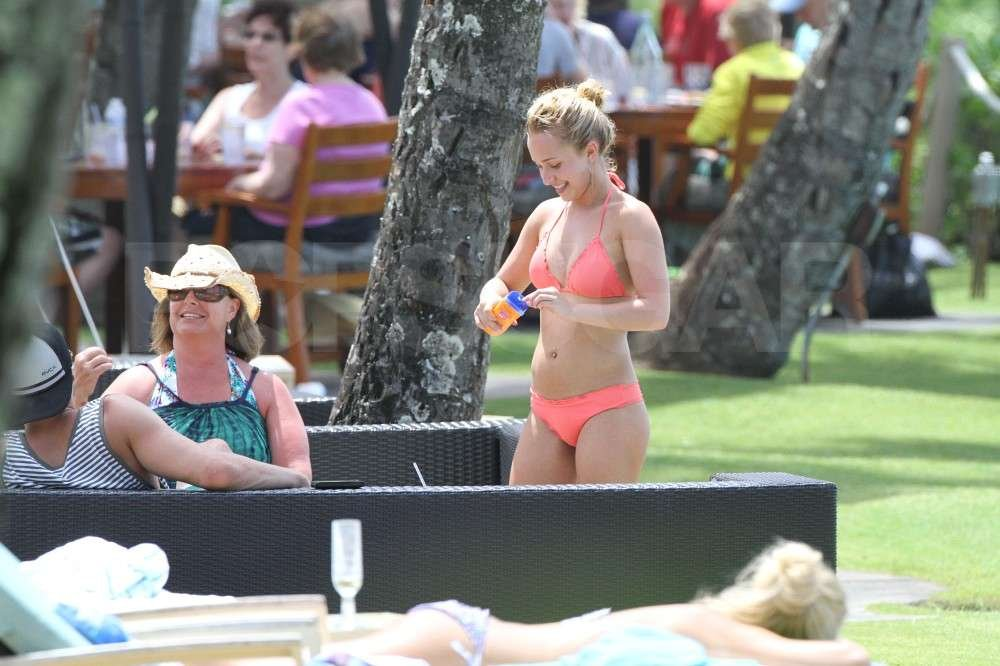Hayden Panettiere applied sunscreen while wearing a bikini on vacation in Hawaii with boyfriend, New York Jets wide receiver, Scotty McKnight.