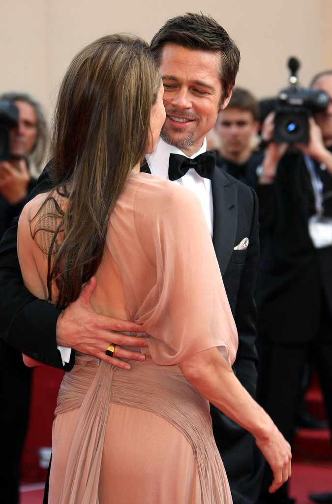 Angelina Jolie stuck close to Brad Pitt at the 2009 Cannes Film Festival premiere of Inglourious Basterds.