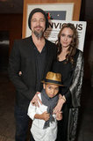 Maddox Jolie-Pitt accompanied his famous parents to the December 2009 LA screening of Matt Damon's Invictus.