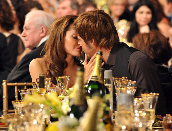 Angelina Jolie planted a kiss on Brad Pitt during the SAG Awards in January 2007.