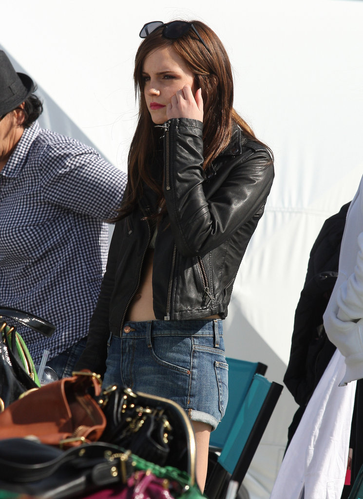 Emma Watson wore a leather jacket and denim shorts on the set of The Bling Ring in Venice.