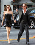 Brad held onto Angelina's hand while arriving at her July 2010 premiere of Salt in LA.