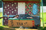 Glastonbury Music Festival goers napped together.