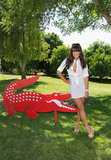 Lea Michele posed with Lacoste's signature croc during their pool party in 2012.