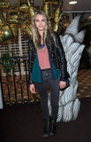 Cara Delevingne topped her colourful layers with a slick black leather jacket at the Mulberry fire pit party.