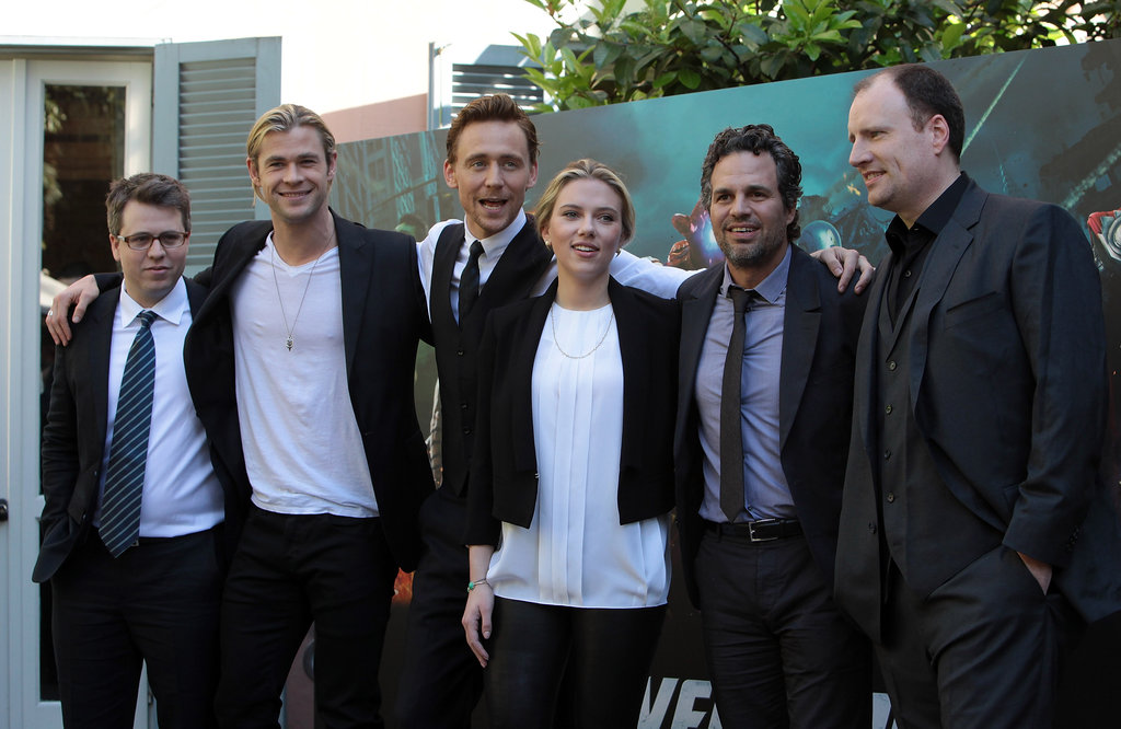 Scarlett Johansson, Chris Hemsworth, and Mark Ruffalo posed with execs.