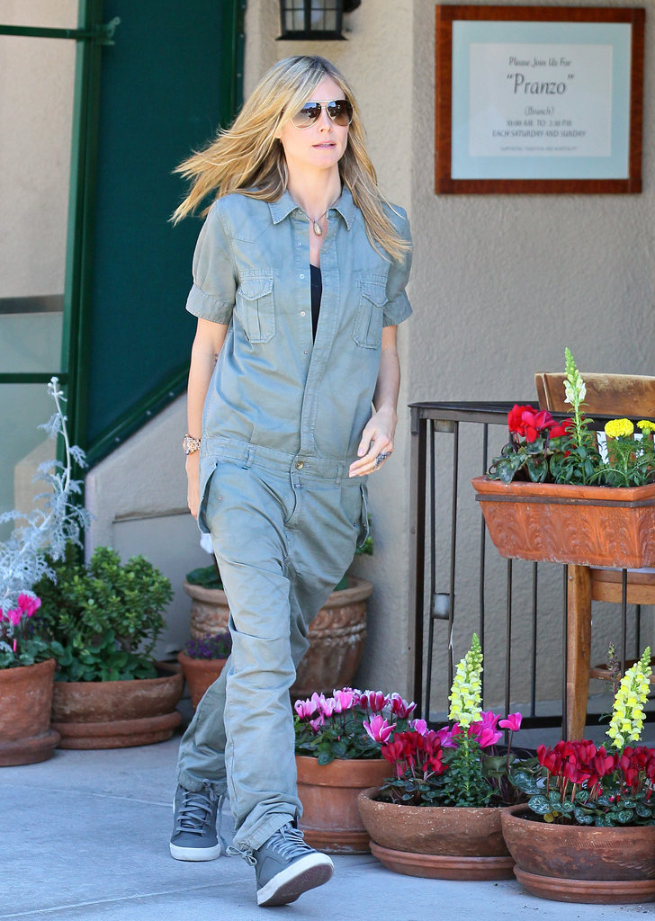 Heidi Klum owns several pairs of stylish sneakers. Here she wore a gray pair with a baggy jumpsuit.