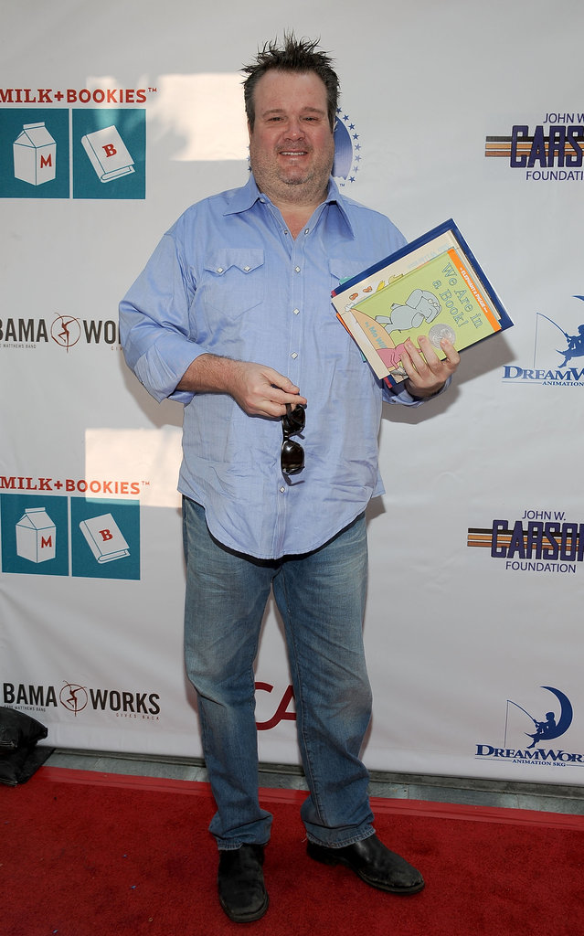 Eric Stonestreet held up the book he was planning to read to the kids.