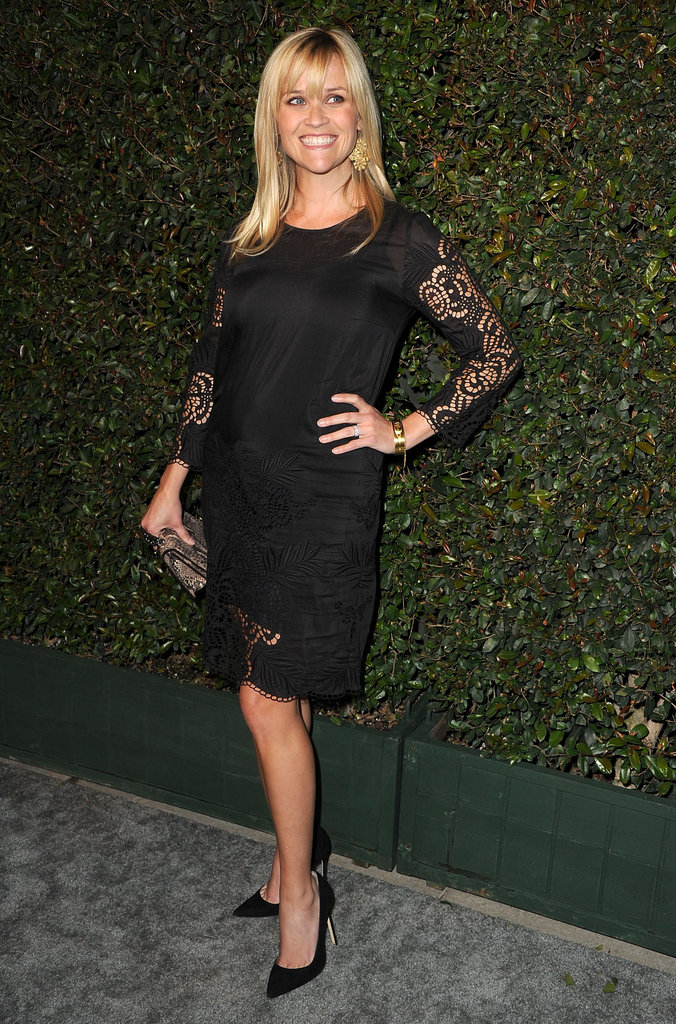 Reese Witherspoon opted for a more covered-up take on sheer with lace sleeves and trim on her black shift.
