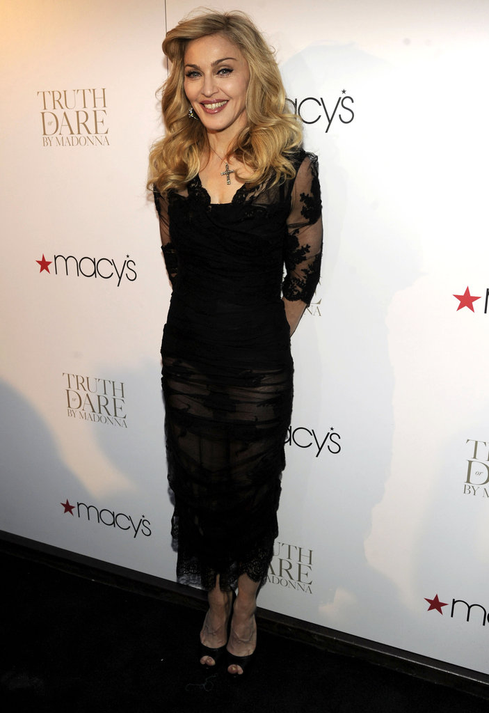 Madonna kept to her usual fitted, long silhouette, with sheer sleeves, in Dolce & Gabbana.