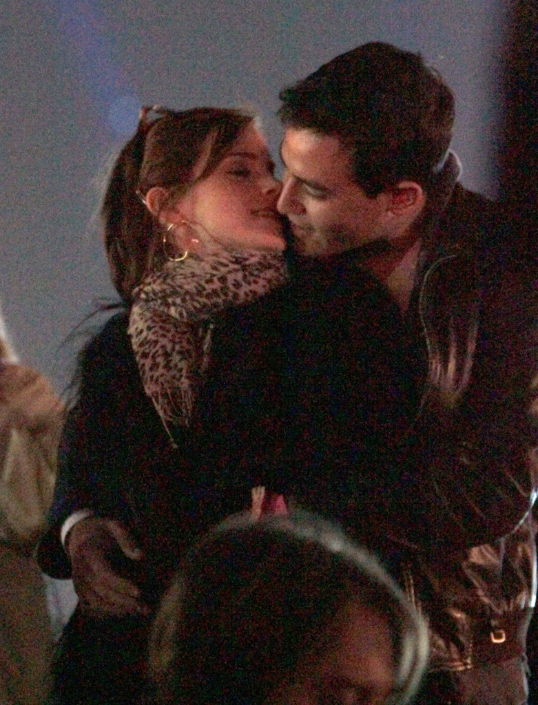 Emma Watson kissed her new boyfriend Will Adamowicz on Sunday.