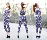 We love how this styler pares down a printed jumpsuit with modern, walkable sandals. Photo courtesy of Lookbook.nu