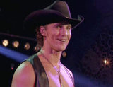 Matthew McConaughey wears a cowboy hat on stage.