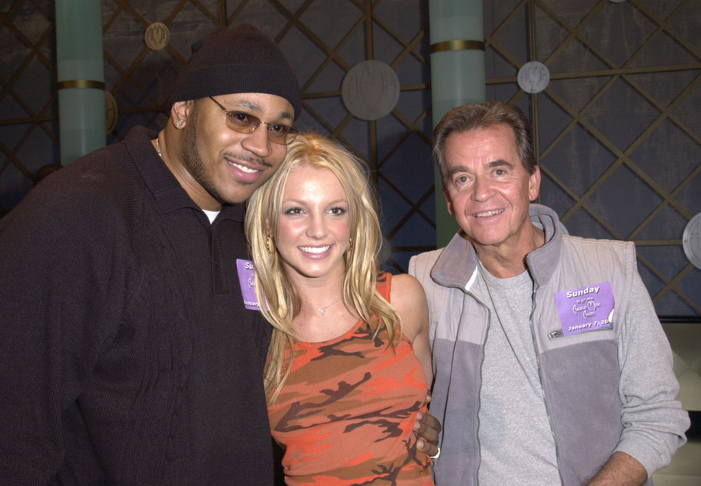 LL Cool J and Britney Spears said hello to Dick Clark at the American Music Awards rehearsals in January 2001.