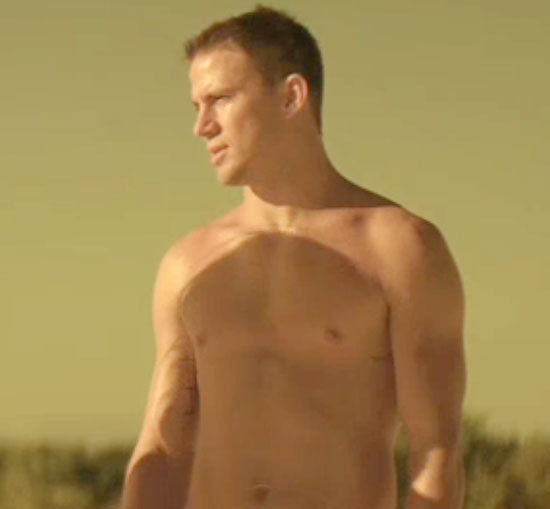 Channing Tatum shows off his abs during a beach scene.