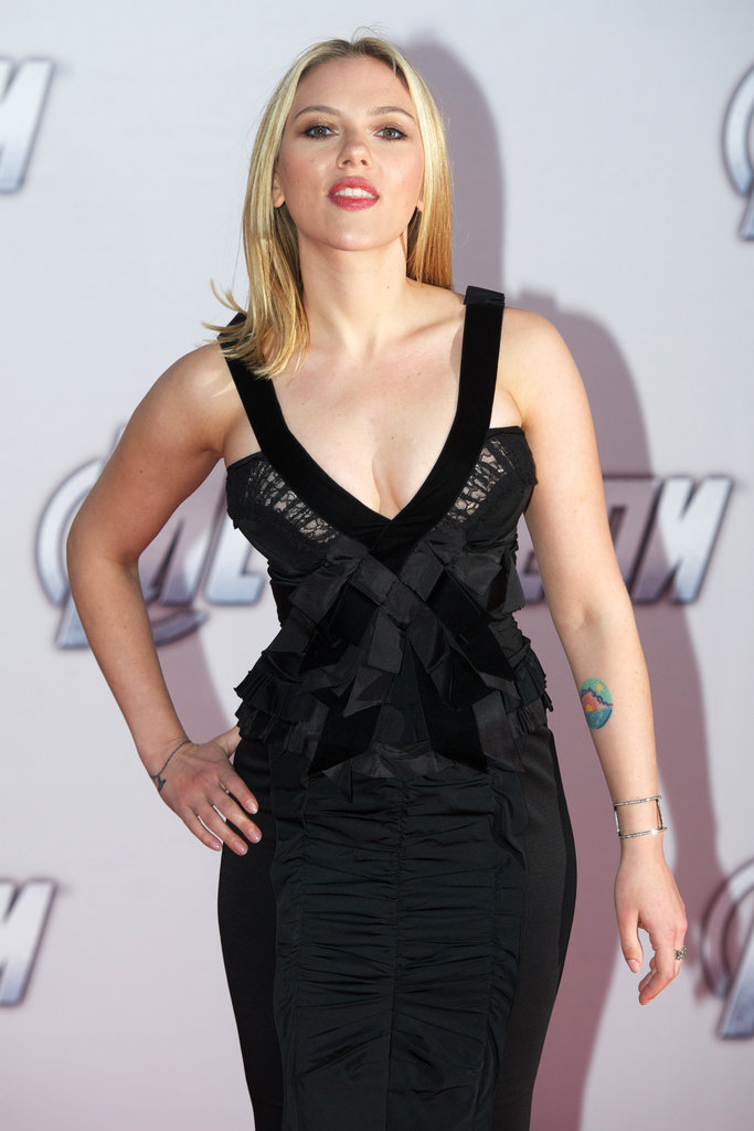 Scarlett Johansson wore a Nina Ricci plunging dress.