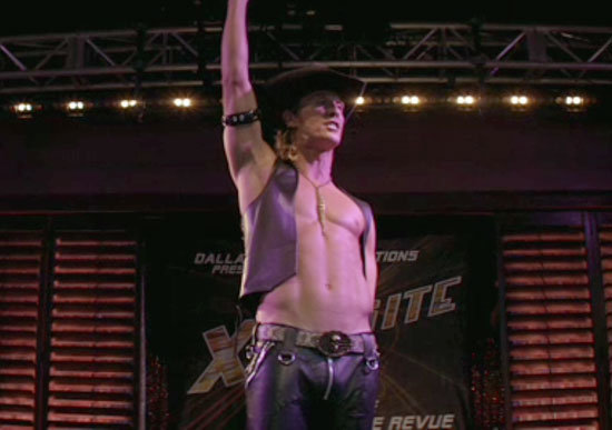 Matthew McConaughey goes shirtless on stage.