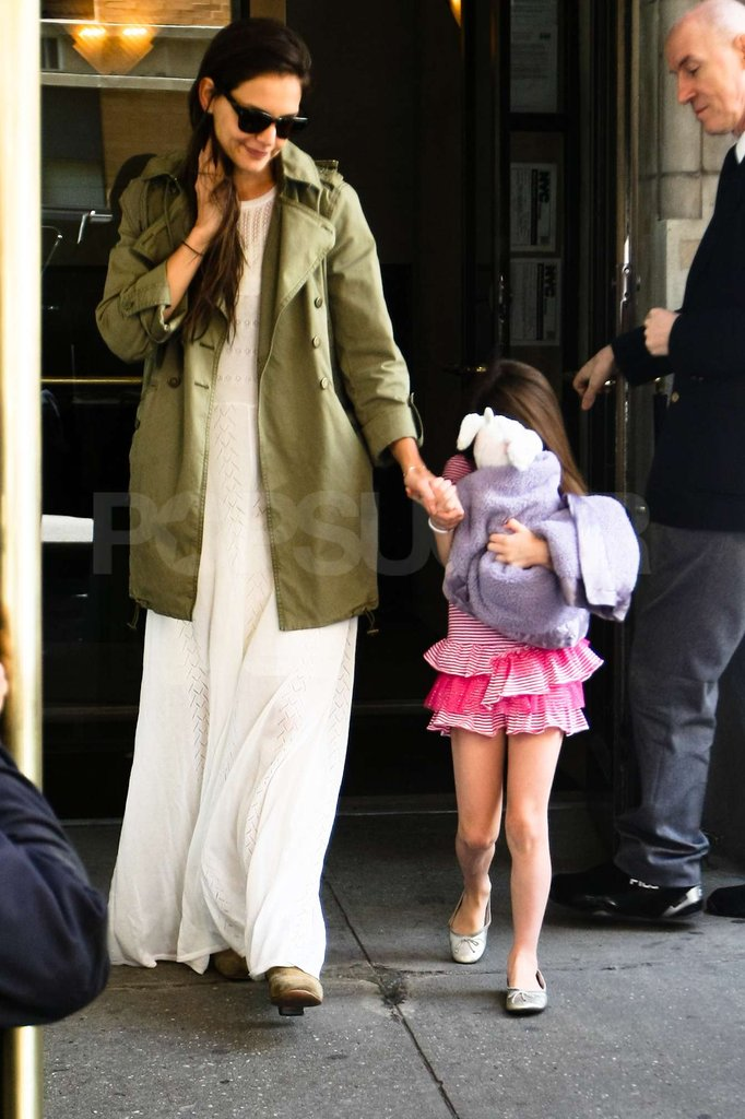 Katie Holmes and Suri Cruise were hand in hand leaving their NYC apartment on Suri's 6th birthday.