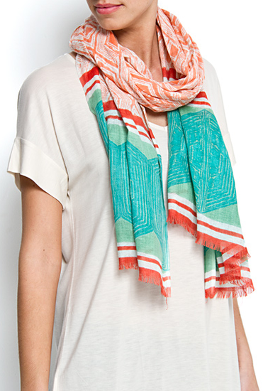 The bright, geometric-print scarf transforms a white tee or maxi dress. Mango Touch Tribal Print Foulard ($20)
