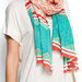 The bright, geometric-print scarf transforms a white tee or maxi dress.