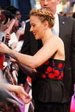 Scarlett Johansson signed autographs for fans at the premiere of The Avengers in London.