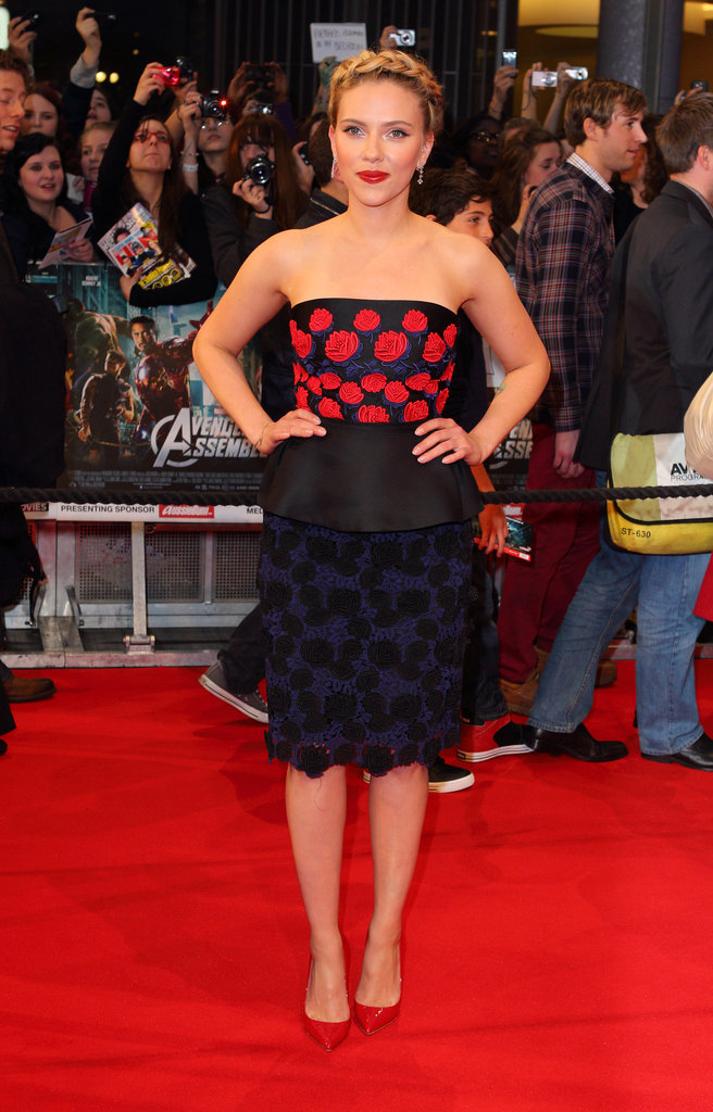 Scarlett Johansson stepped onto the red carpet in a flowered Prada dress for the premiere of The Avengers in London.