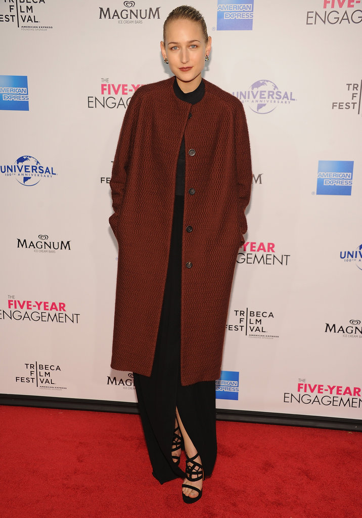 Leelee Sobieski continues her Tribeca Film Festival circuit with this darker number — a cool departure from her crisp white Jil Sander number spotted at the Vanity Fair party. Her crimson The Row jacket covered her sleek black dress, but keep clicking to see her outfit in full.
