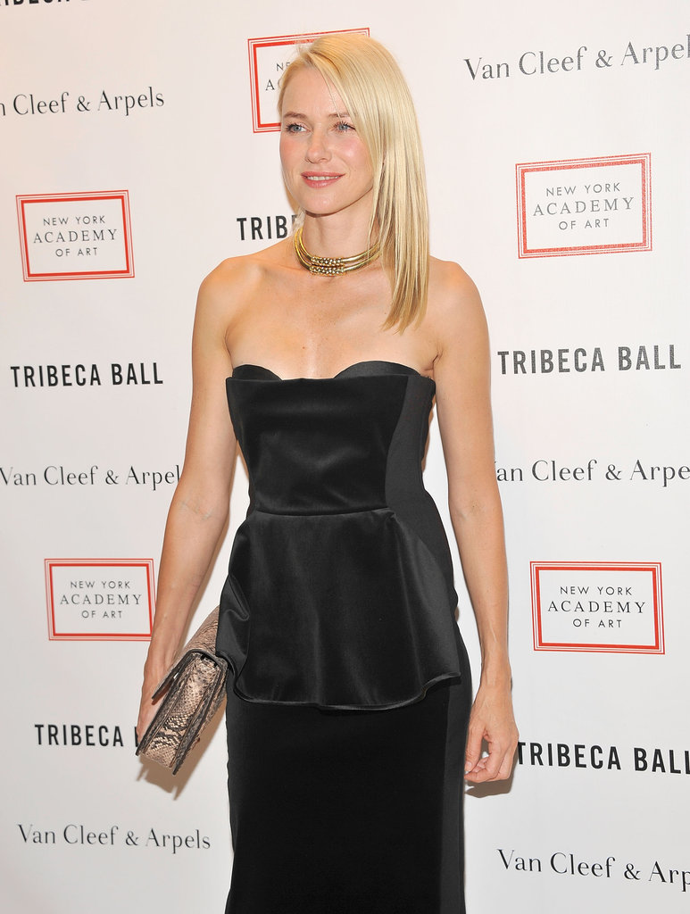 Naomi Watts added some glitz to her strapless black gown with a tribal-cool gold collar necklace.