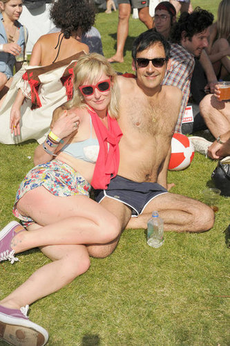 A couple soaked up the sun during the Lacoste Live desert pool party at Coachella.