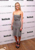 Taylor Schilling wore a gray belted dress to the Cinema Society and Men's Health screening of The Lucky One in NYC.