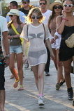 Emma Roberts wore a sheer mesh dress over her bikini at the second weekend of Coachella 2012.