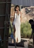 Rihanna wore an elegant gown with a slit for a shoot for Harper's Bazaar in Malibu.