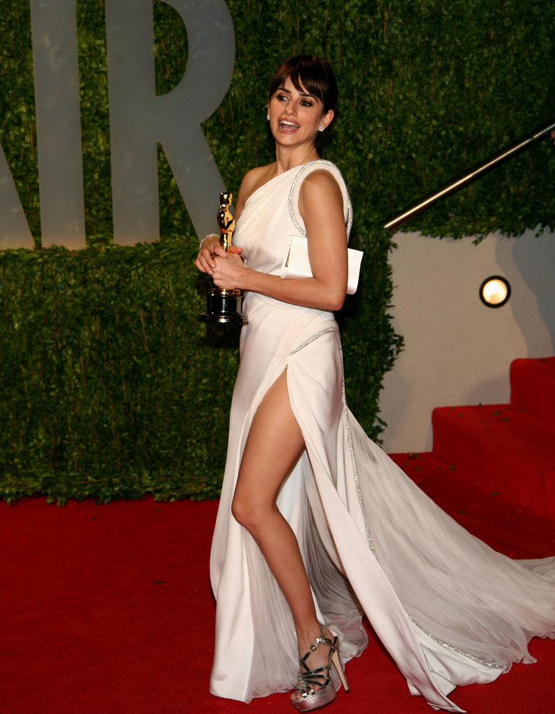 After winning the best supporting actress Oscar for her role in Vicky Cristina Barcelona in February 2009, Penélope Cruz partied in a Grecian white gown with a thigh-high slit at the Vanity Fair Oscars party in LA.