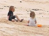 Knox and Vivienne played in the sand on their family trip.