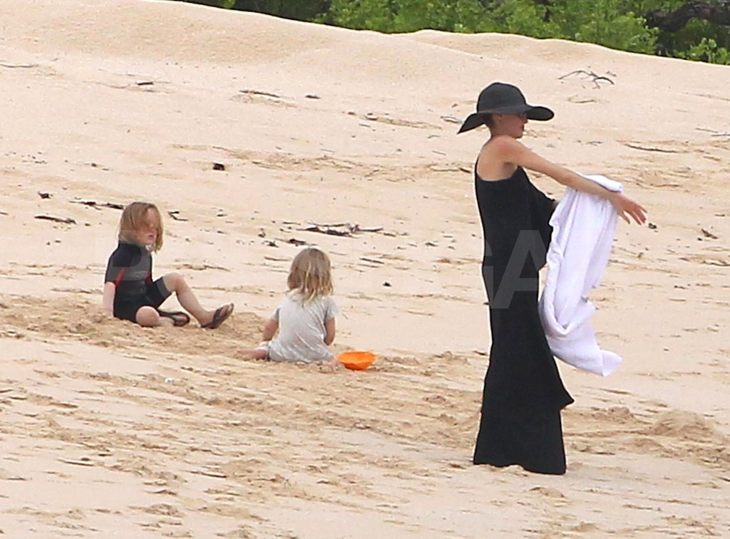 Angelina wore a long black dress on their trip.
