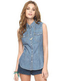Dress this sleeveless denim top up with a collar necklace or inject a preppier feel with a nautical-striped cardigan. Forever21 Sleeveless Snap Button Denim Shirt ($18)