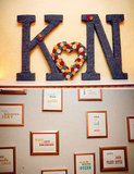 "Give the gallery wall trend a wedding makeover with a series of ""You're the X to my X"" signs that speak to your different personalities. Source: Bryan Rupp Photography via Green Wedding Shoes"