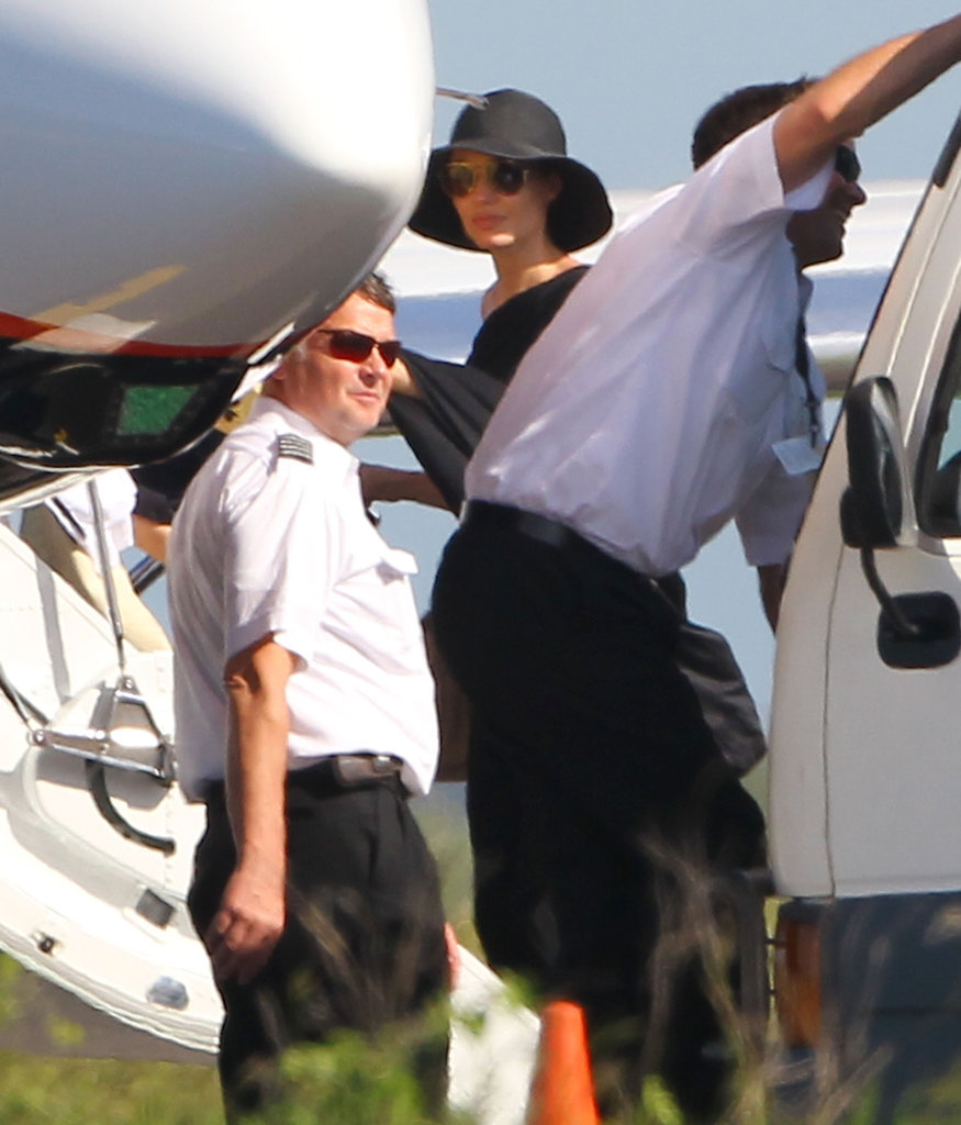 Angelina Jolie climbed onboard a private jet with her family after a week's vacation in the Galapagos Islands.