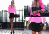 Black and neon pink look killer for Spring, especially on a chic blouse and evening shorts.  Photo courtesy of Lookbook.nu