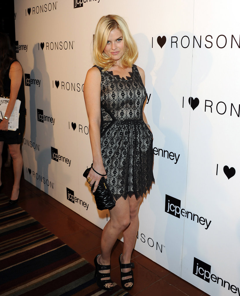 Showing off a flirty sheer frock for a Charlotte Ronson event in June 2011.