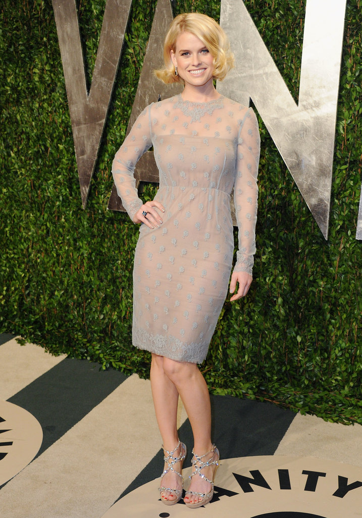 At Vanity Fair's Oscars fete, Alice channeled feminine glamour in a sparkly fitted sheath and coordinating heels.